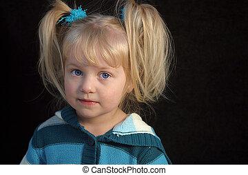 Toddler Girl - A toddler girl with a shy smile