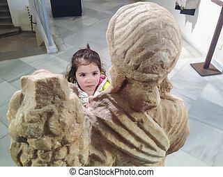 Toddler girl at roman museum - Toddler girl observing a...