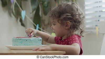 Toddler girl celebrating birthday during COVID-19 lockdown. ...