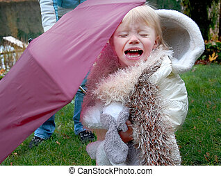 Toddler Girl Crying With Burgundy Umbrella