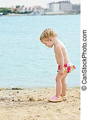 toddler girl on the beach