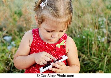 toddler girl playing smartphone