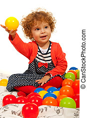 Toddler girl playing with balls