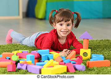 Toddler girl posing in her room