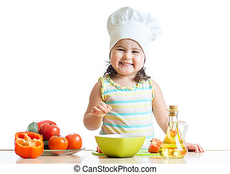 toddler girl preparing healthy food in the kitchen