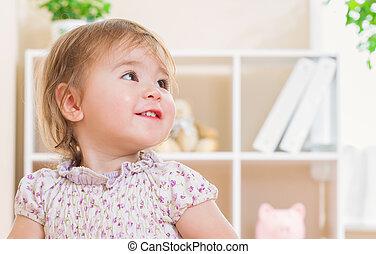 Toddler girl with a giant smile