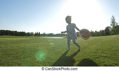 Toddler girl with down syndrome walking on grass