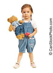 Toddler girl with teddy bear in jeans - Toddler girl holding...