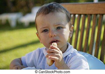 Toddler having a snack