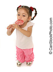 Toddler holding a lollipop