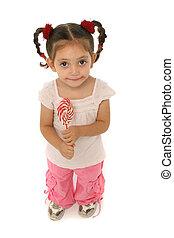 Toddler holding a lollipop