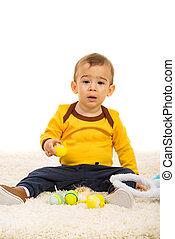 Toddler holding Easter eggs