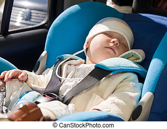 Toddler in a car seat - Toddler sleeping in a car seat