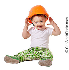 Toddler in hardhat plays over white background