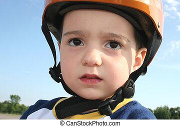 Toddler in Helmet - Three year old boy in bicycle helmet.