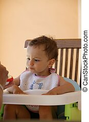 Toddler in high-chair