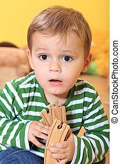 Toddler in kindergarten - Cute caucasian toddler in...