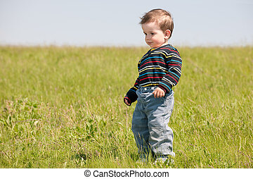 Toddler in the spring meadow