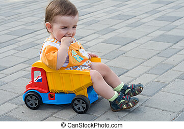toddler in the truck