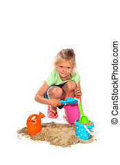 Toddler is playing in the sand