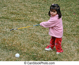 Toddler learning golf
