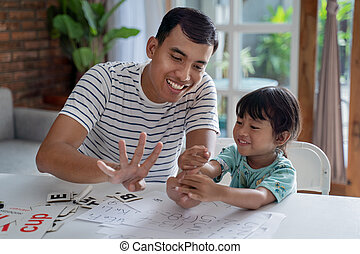 toddler learning math and counting with her father