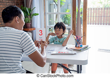 toddler learning simple math using flash card at home