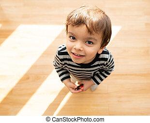 Toddler looking up at the camera