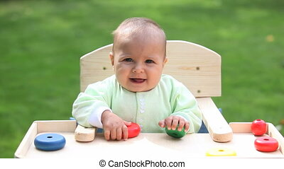 Toddler on chair