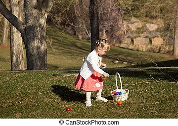 Toddler on Easter Egg Hunt - Little toddler girl on Easter...