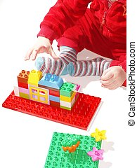 Toddler playing building toys