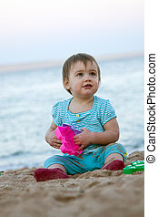 Toddler playing on sand