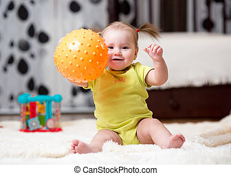 toddler playing with ball indoor