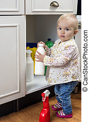 Toddler playing with cleaning products - Little child ...