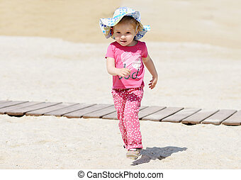 toddler running on the beach
