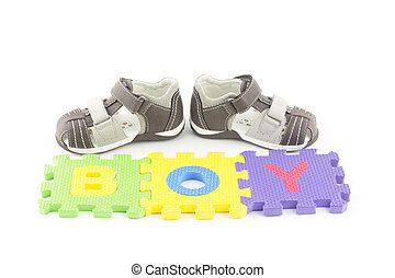 Toddler sandals and alphabet puzzle pieces