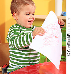 Toddler showing his picture