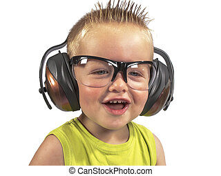 toddler sitting with headphones on his head on a white...