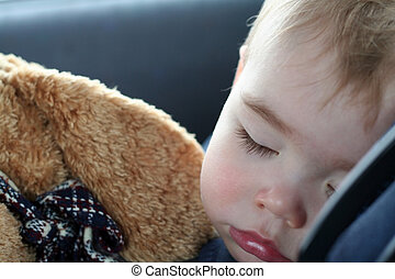 Toddler Sleeping - A toddler sleeping in his car seat