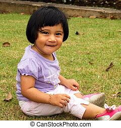 Toddler - Smiling girl having fun at the playground.