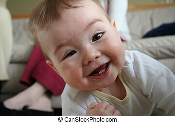 Toddler Smiling - A toddler crawling around the living room...