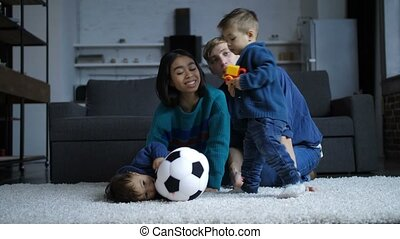 Toddler son kissing hindu mother at home - Happy young multi...