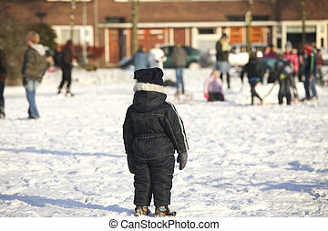 Toddler standing on ice