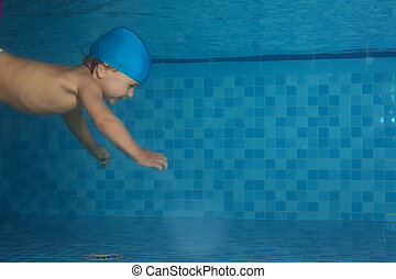 Toddler swimming in the pool