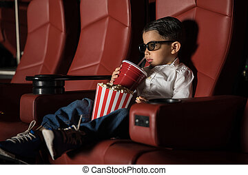 Toddler watching movie at a cinema theater