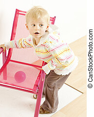 toddler with a chair