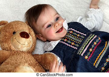 Toddler with a Teddy Bear