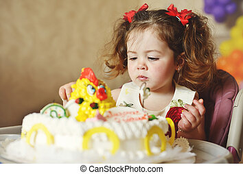 toddler with cake
