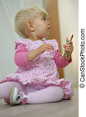 Toddler with colorful crayons