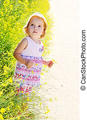 toddler with flower
